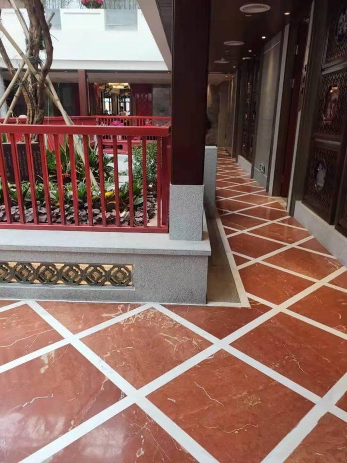 广州陶陶居选择珊瑚红的装饰风格,效果杆杆的!